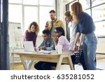 group of serious team members... | Shutterstock . vector #635281052