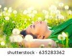 beautiful young woman lying on... | Shutterstock . vector #635283362