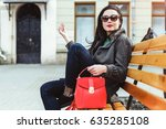 woman sitting on the bench with ... | Shutterstock . vector #635285108