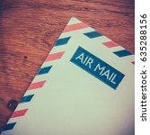 Small photo of Retro Photo Of An Old Air Mail Envelope Of A Rustic Wooden Background