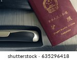chinese passport and suitcase | Shutterstock . vector #635296418