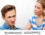 woman comforting her sad husband | Shutterstock . vector #635299952