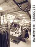 Small photo of Blurred interior of sports and fitness clothing store in America. Activewear shop, famous brand worldwide of athletic shoes, gear and apparel with mannequins. Healthy lifestyle concept. Vintage tone.