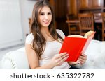 portrait of a woman reading a... | Shutterstock . vector #635322782