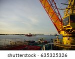 Small photo of Pedestal crane boom up on offshore vessel with background of vessel at Labuan Anchorage, Labuan,Malaysia.