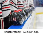 hockey players stand at bench... | Shutterstock . vector #635334536