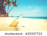 beer bottle on a sandy beach... | Shutterstock . vector #635337722
