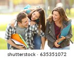 three happy students and... | Shutterstock . vector #635351072