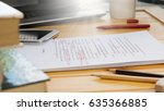 Stock photo proofreading text on table in office 635366885