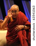 TORONTO-OCTOBER 22: Tibetan spiritual leader Dalai Lama arrived in Toronto for a much-anticipated talk ??Human Approaches to World Peace on Oct. 22, 2010 in Toronto - stock photo