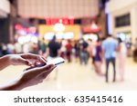 man use mobile phone  blur of... | Shutterstock . vector #635415416