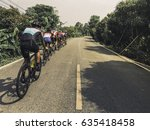 group asian men are cycling... | Shutterstock . vector #635418458