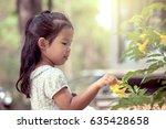 portrait of cute asian little... | Shutterstock . vector #635428658