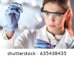life scientists researching in... | Shutterstock . vector #635438435