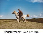 man galloping on white horse | Shutterstock . vector #635474306