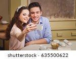 young beautiful enamored couple ... | Shutterstock . vector #635500622