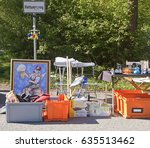 Small photo of ECHING, GERMANY - APRIL 30, 2017 - the open air spring flea market, objects exposed on the sidewalk in Eching, Bavaria, Germany.