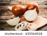 a sliced organic onion and... | Shutterstock . vector #635564018