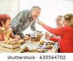 happy senior friends having... | Shutterstock . vector #635564702