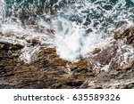 waves beating on a rocky shore. ... | Shutterstock . vector #635589326