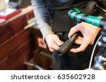 man fixing bicycle in garage | Shutterstock . vector #635602928