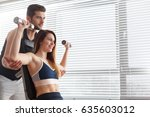 personal trainer and woman... | Shutterstock . vector #635603012