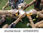 group of friends drinking beers ... | Shutterstock . vector #635604392