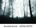 man silhouette in scary forest... | Shutterstock . vector #635614052
