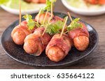 sausage rolled with bacon ... | Shutterstock . vector #635664122