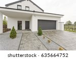 driveway and main entrance to... | Shutterstock . vector #635664752