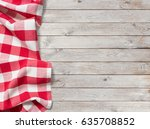 red picnic tablecloth on white... | Shutterstock . vector #635708852