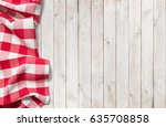 red picnic cloth on white wood... | Shutterstock . vector #635708858