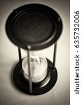 large black hourglass against a ... | Shutterstock . vector #635732006