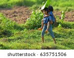Small photo of Sister and sister play on green field in the daytime. Concept sister and sister together forever