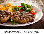 grilled beef steak with french... | Shutterstock . vector #635796902
