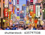 Small photo of TOKYO, JAPAN - MAY 7, 2017: Crowds pass through Kabukicho in the Shinjuku district. The area is an entertainment and red-light district.