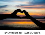 silhouette hand of couple in... | Shutterstock . vector #635804096