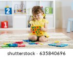 little girl child playing with... | Shutterstock . vector #635840696