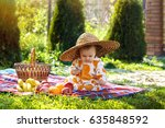 baby sitting on the grass with... | Shutterstock . vector #635848592