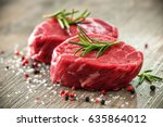 raw beef fillet steaks with... | Shutterstock . vector #635864012