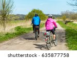 older people ride a bike in the ... | Shutterstock . vector #635877758
