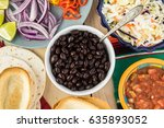 top view of bowl with black... | Shutterstock . vector #635893052
