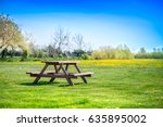 picnic table on a green meadow... | Shutterstock . vector #635895002