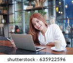 asian woman working with laptop ... | Shutterstock . vector #635922596