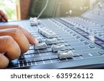 hand adjusting audio mixer... | Shutterstock . vector #635926112