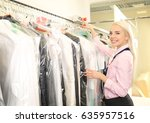 female laundry worker pushing... | Shutterstock . vector #635957516