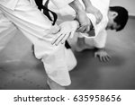 fight between two aikido... | Shutterstock . vector #635958656