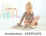 Cute Little Girl Playing With...