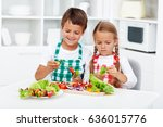 young kids preparing vegetables ...