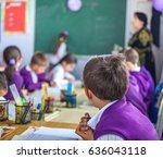 school children are... | Shutterstock . vector #636043118
